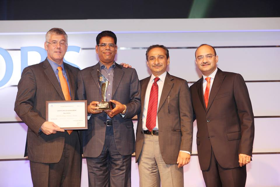 Our beloved MD Mr. KP Nair receiving highest NANO Car Sales Award 2012-13 from TATA Motors' MD Mr. Karl Slym.